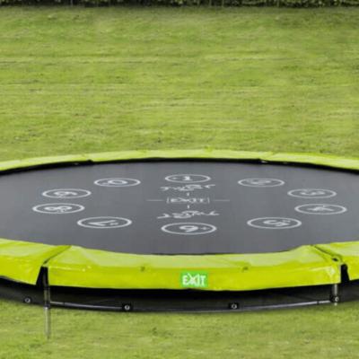 trampline enterré dans le sol marque Exit Toys