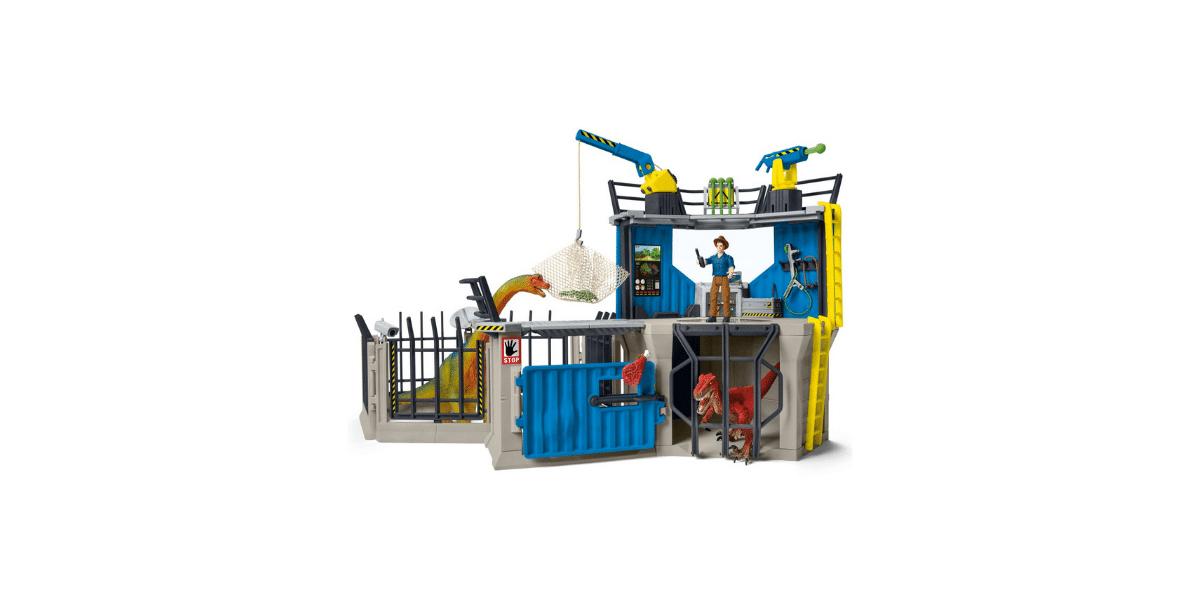 station de recherches avec plsuieurs dinosaures dans des cages un personnage à l'étage avec talkie walkie